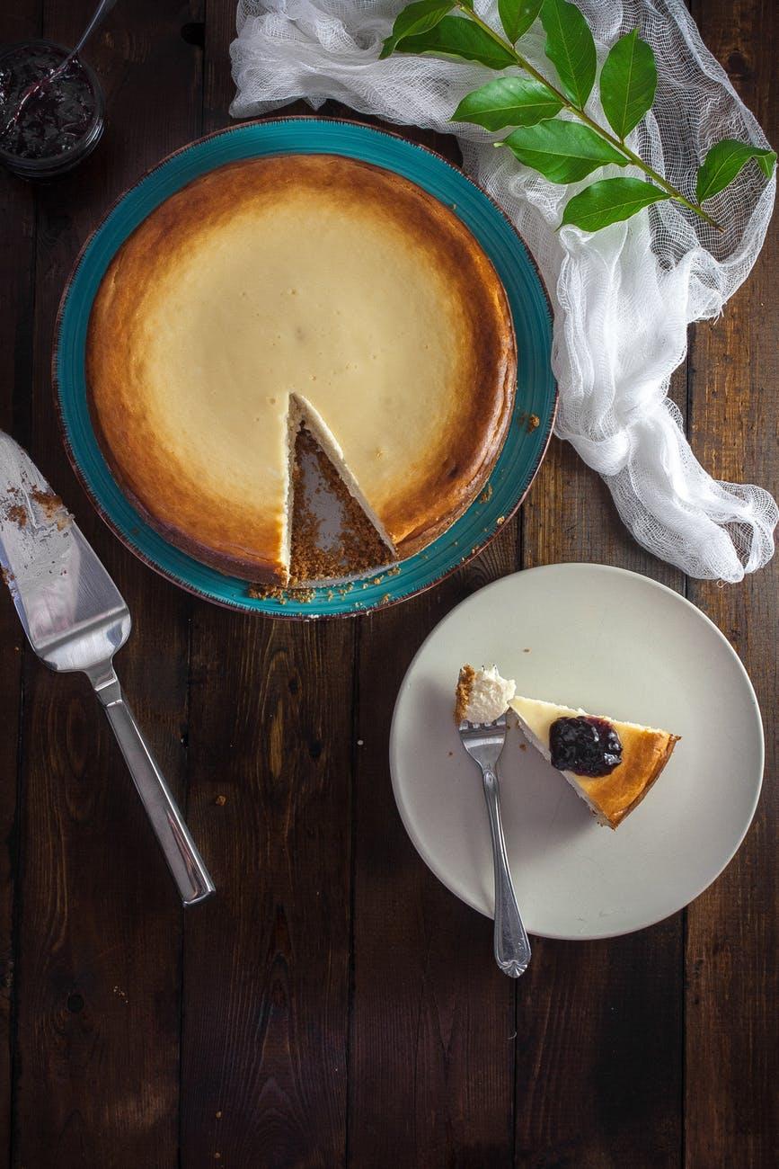 slice of pie on plate beside fork